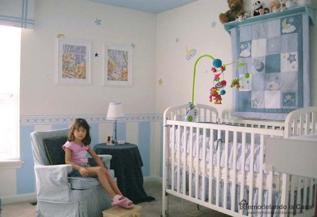 baby blue color nursery with stripes and stars, quilt art on wall