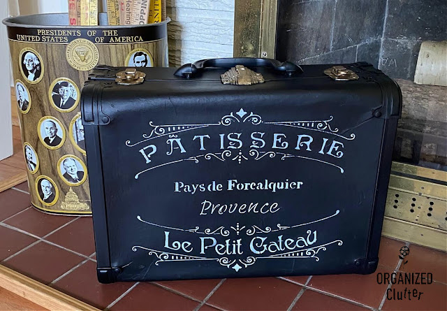 Photo of an upcycled and stenciled vintage suitcase