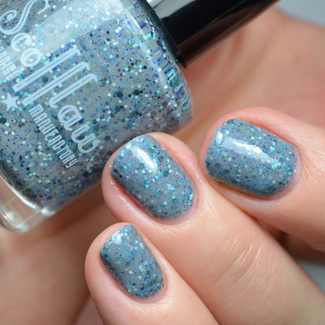 grey nail polish with glitter swatch