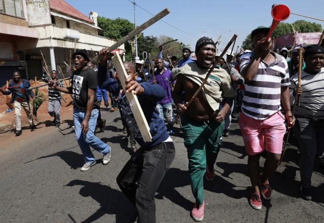 Xenophobic: 12 dead as South African attacks on foreign shops continue
