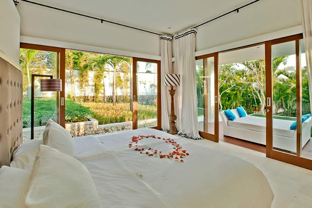 Picture of modern bedroom surrounded by vegetation