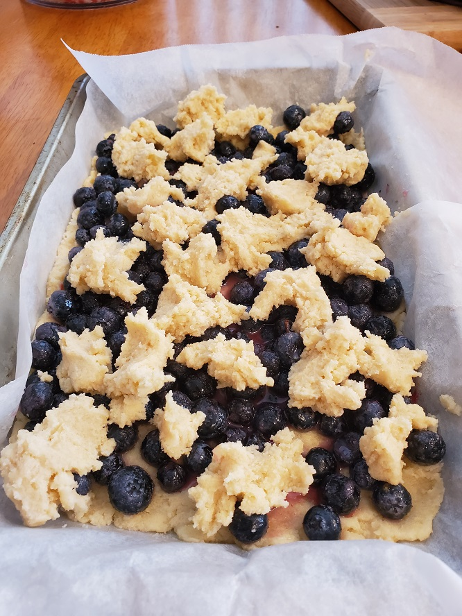 this is blueberry bars raw on parchment paper ready for baking in the oven