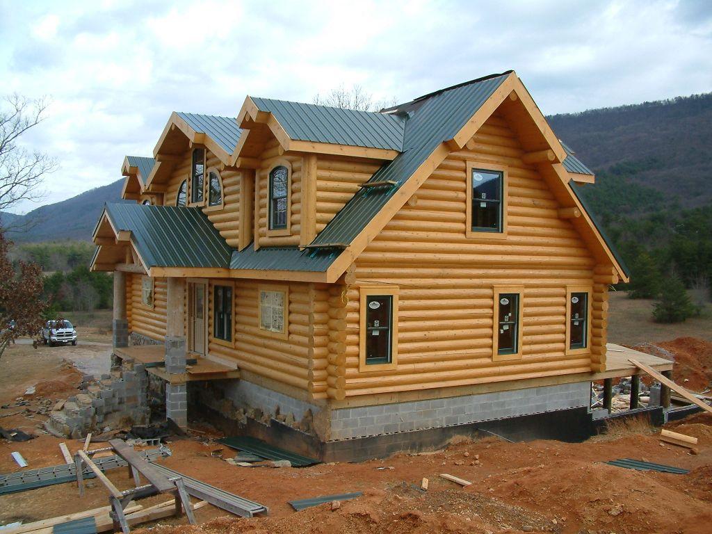 casa de madera ladrillo y vidrio moderna
