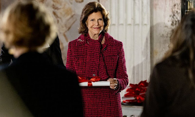 Queen Silvia of Sweden wore a red wool jacket and skirt