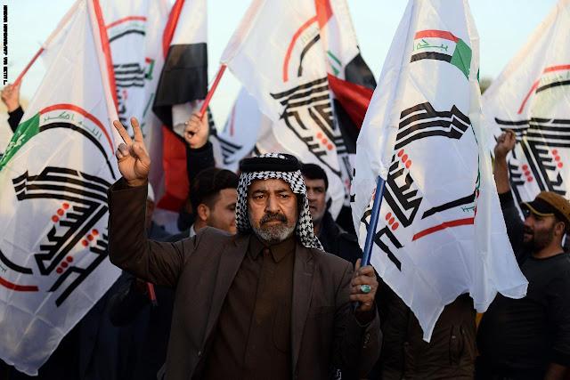 الآلاف من مؤيدي الحشد الشعبي يحاصرون السفارة الأمريكية في بغداد