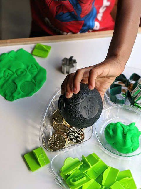 4-year old boy playing with St. Patrick's Day play dough tray