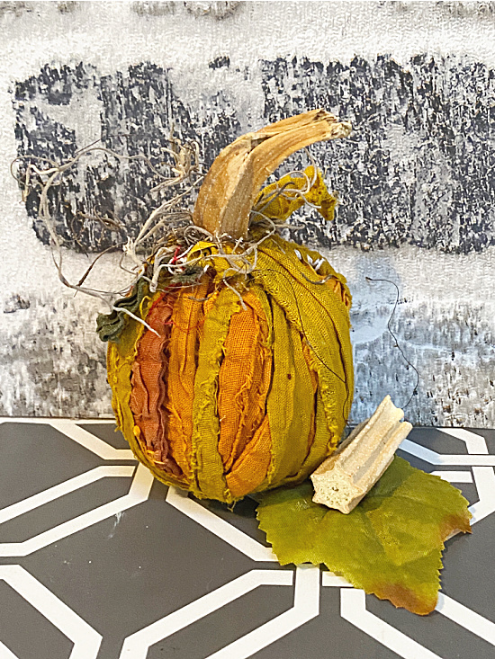 rag pumpkin with moss and stem
