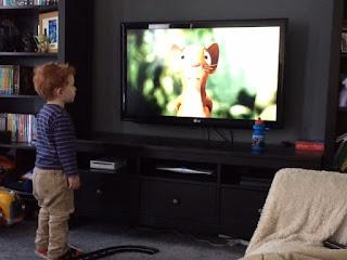 Little boy watching the movie