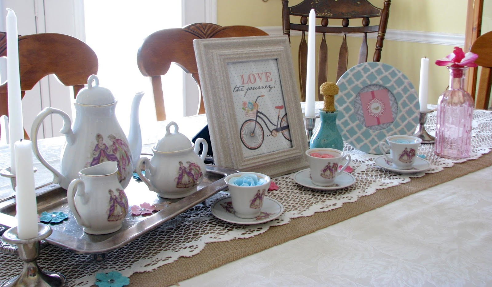 Vintage tea set on a silver tray with other vintage accessories