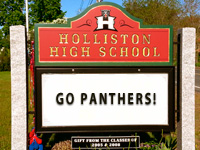"School sign with text ""Go Panthers!"""