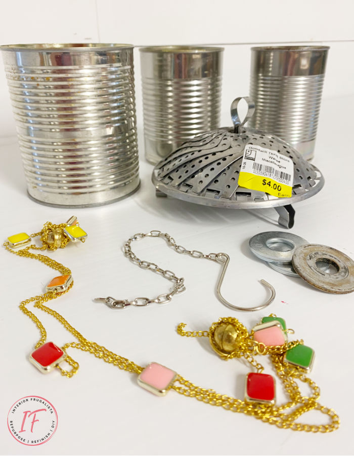How to make bright and whimsical Upcycled Tin Can Wind Chimes with recycled food cans, a vintage strainer, and old necklace for unique garden decor.