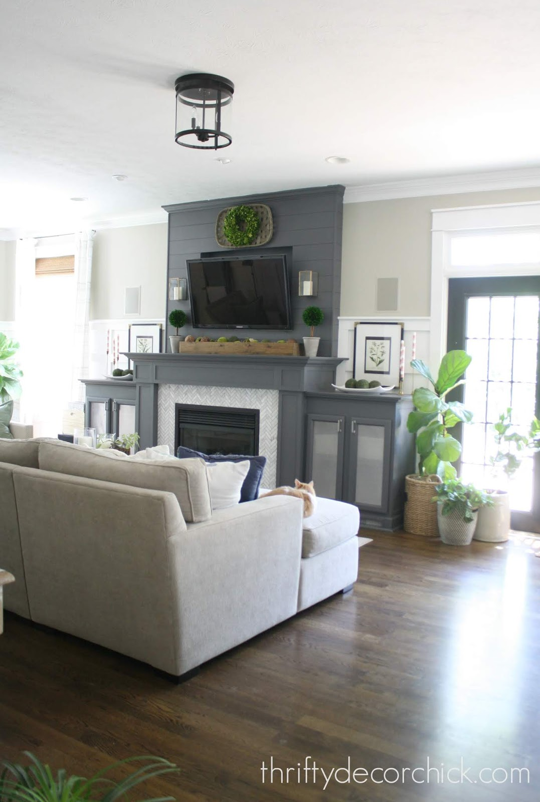 Dark gray fireplace with cabinets