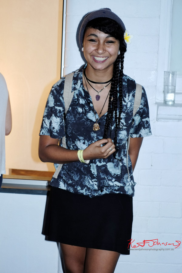 Blue print shirt, black skirt, Buddha necklace  - girl skater at Olsen Irwin art opening Gallery Paddington.