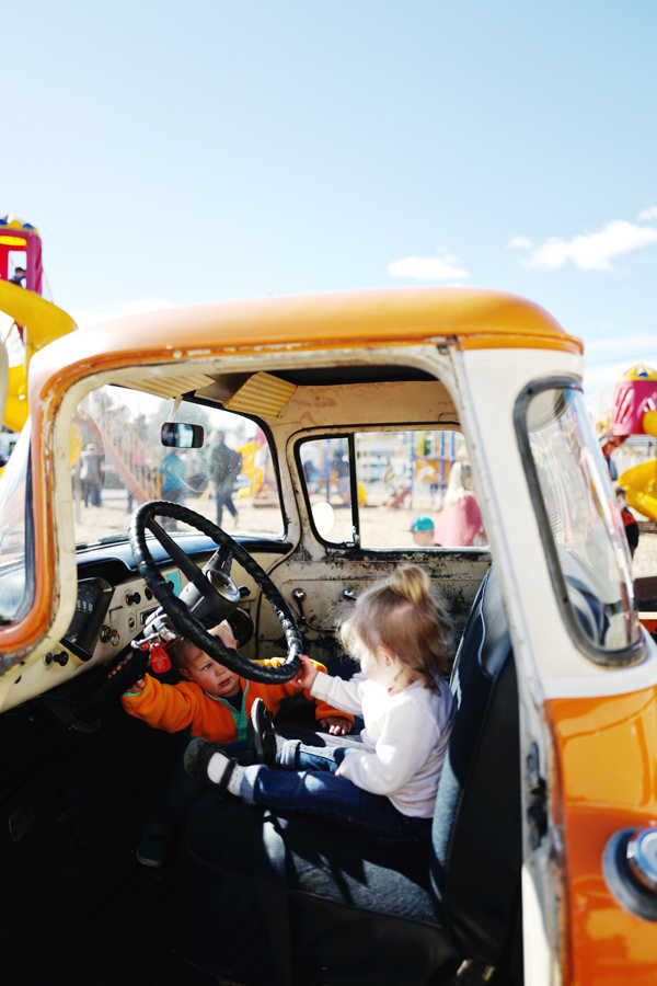 toddlers in a vintage pickup truck