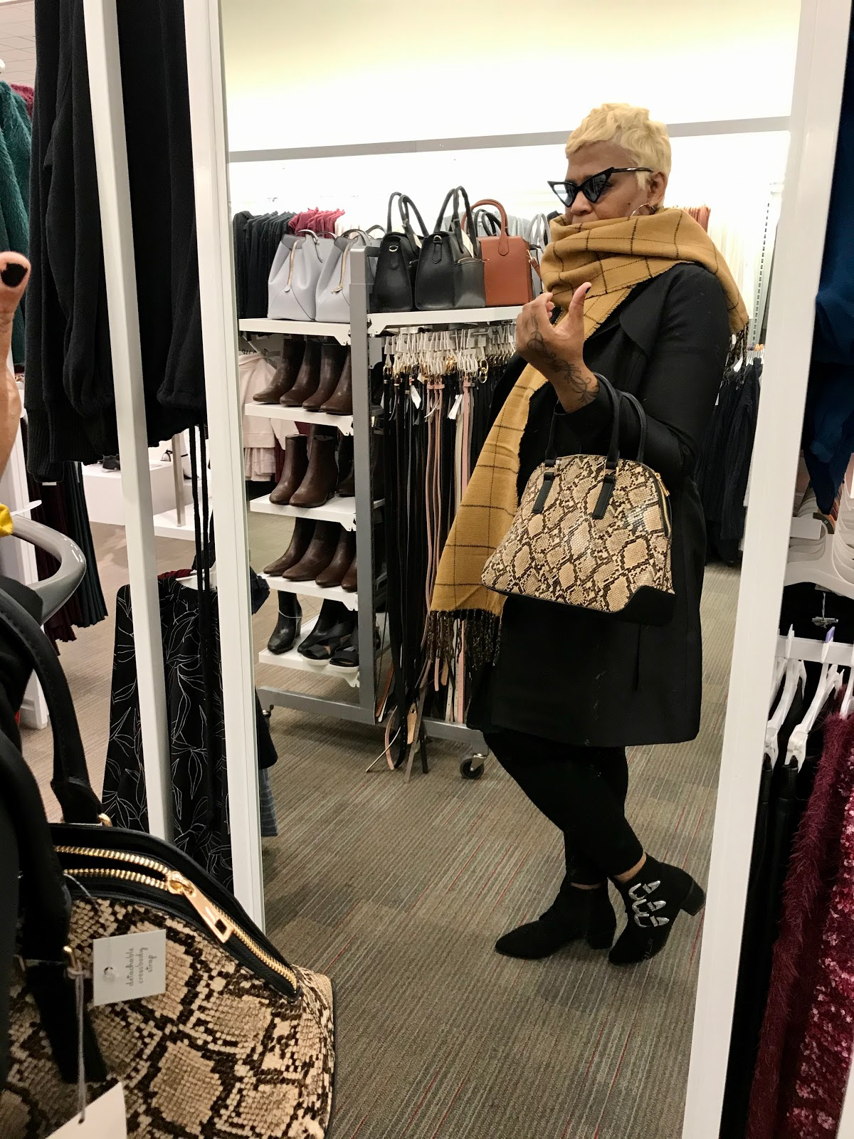 Tangie Bell trying on ore scarves and handbags for the winter at Target. Outfit