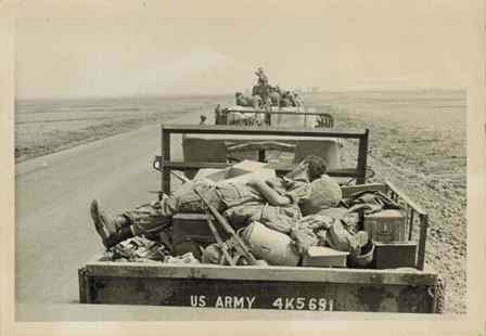 TRUCK LOAD OF DEAD BODIES FROM THE 199th LIGHT INFANTRY BRIGADE LEAVING THE BATTLEFIELD IN THE