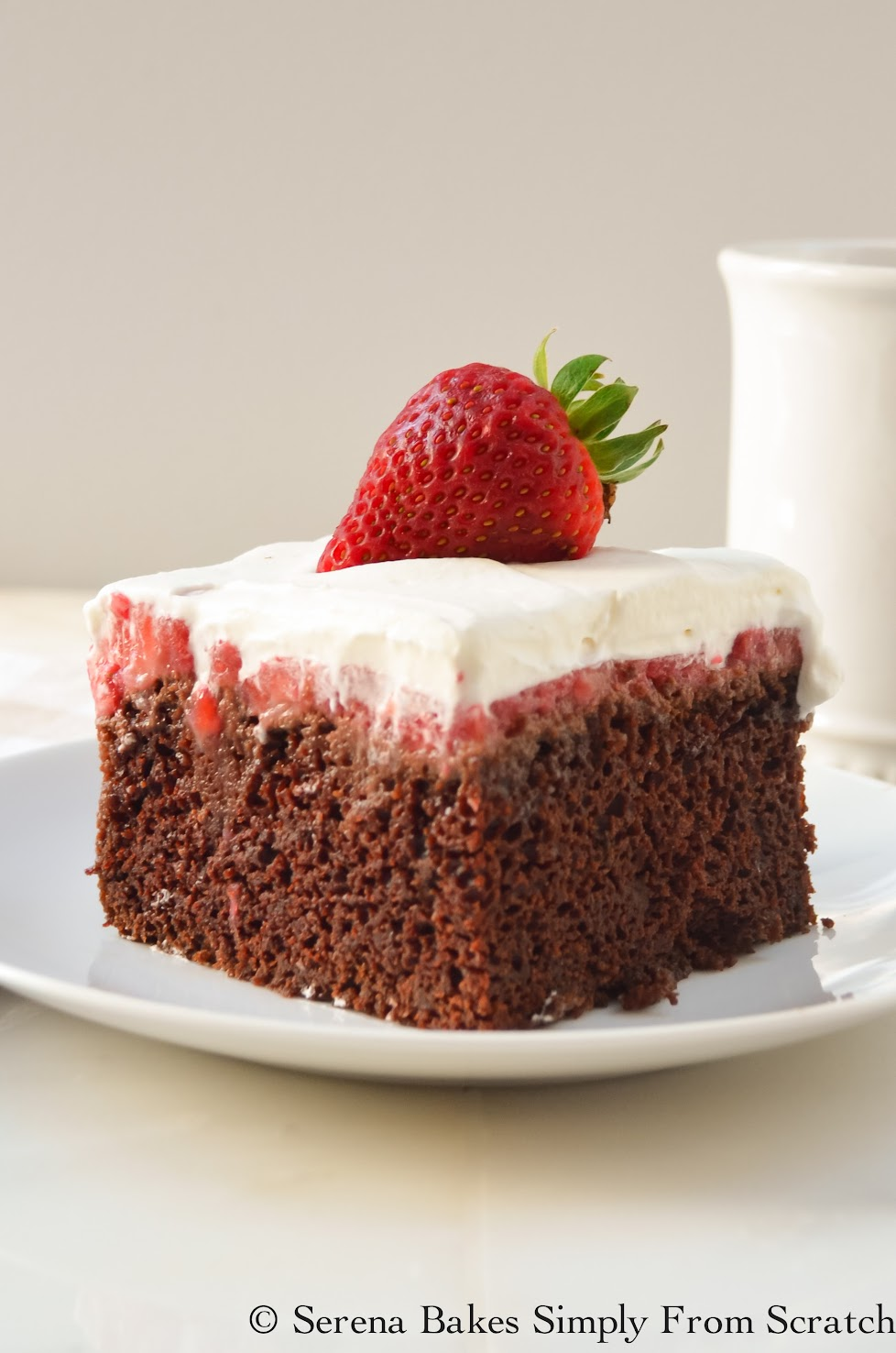 Moist Chocolate Strawberry Poke Cake is a summertime must have! | www.serenabakessimplyfromscratch.com