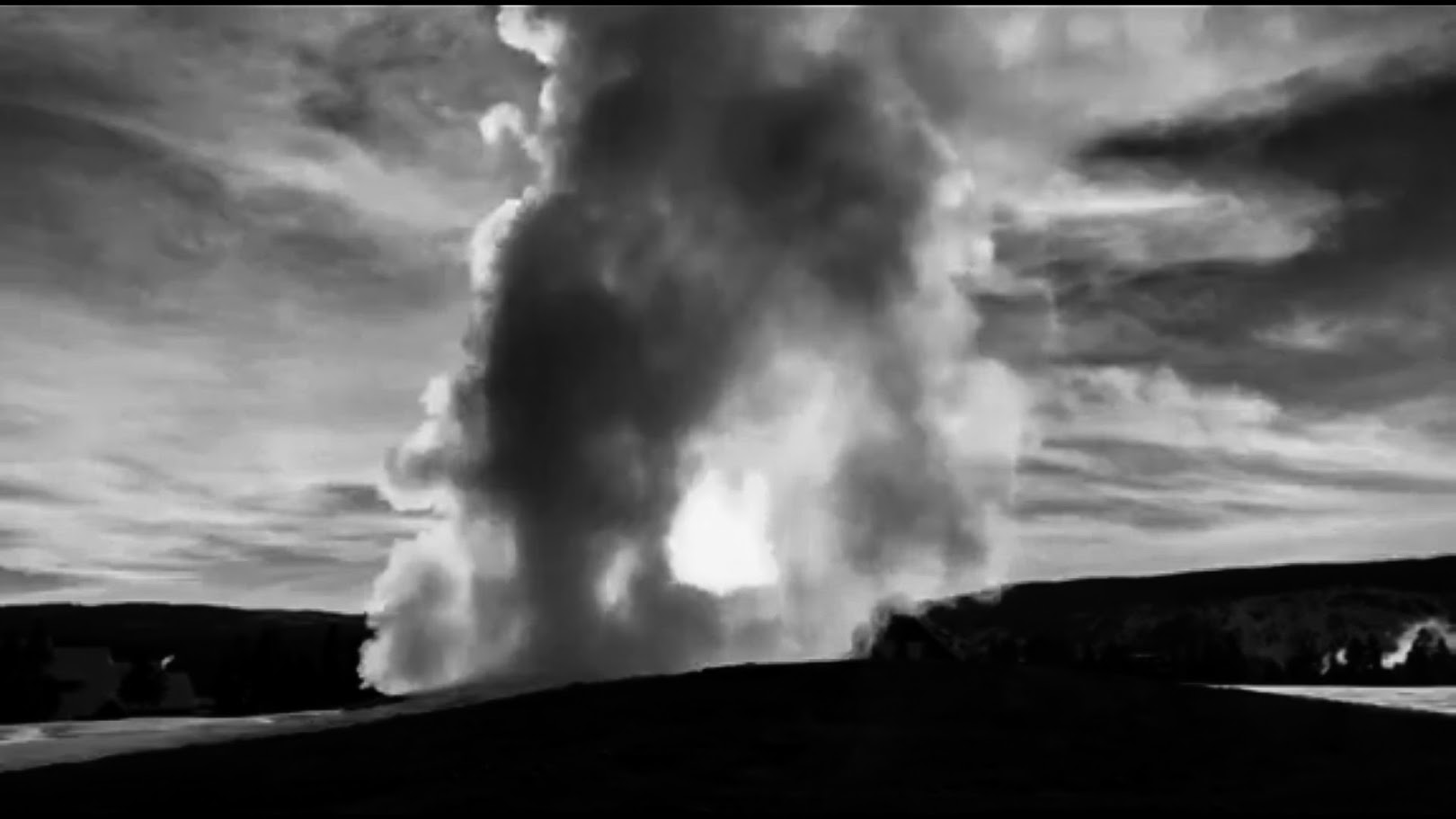 Black and white shot of Old Faithful at sunset