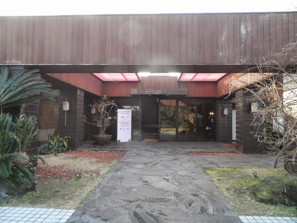 The entrance to the hotel. The design looks like an entrance into a traditional Japanese home with large roof beams and post columns.