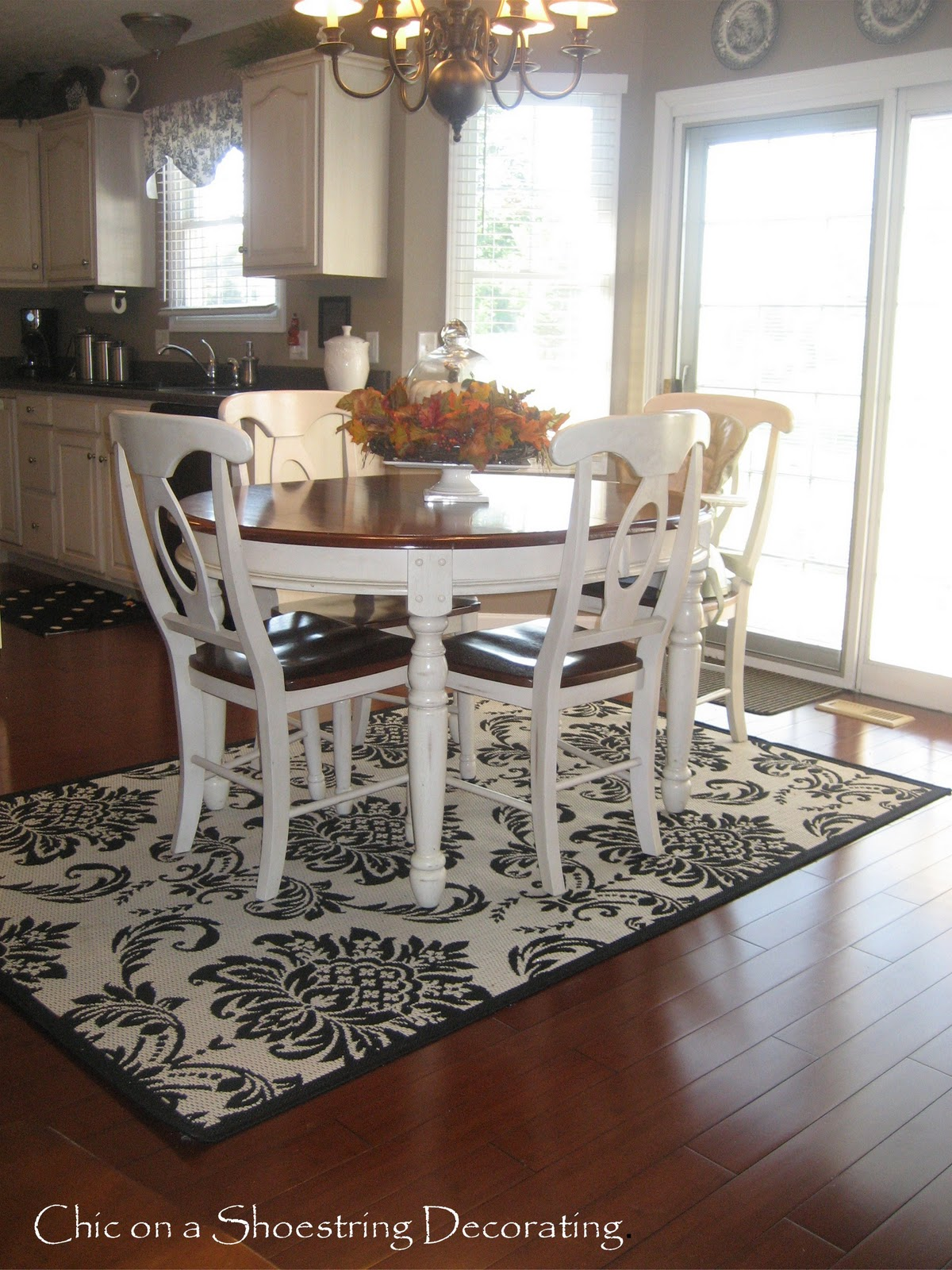 rug for kitchen table cabinets with glass doors round rugs under roselawnlutheran