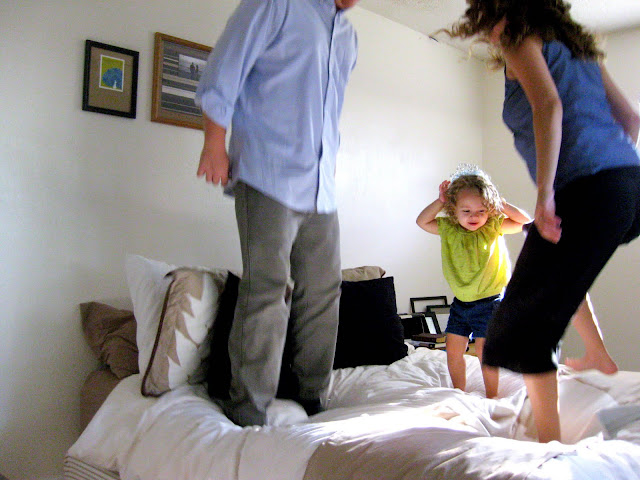 jumping on the bed with the family