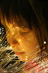 child with fibre optic ornament