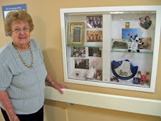 Her Display cabinet in the hall.