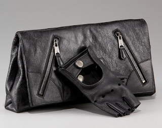 The one and only way to hold a McQueen Clutch!