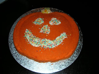 Cake Decorated to look like a carved pumpkin