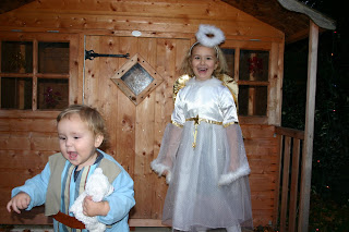 Top Ender dressed as an Angel with Baby Boy dressed as a shepherd running away