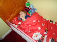Baby Boy in bed on Christmas Eve