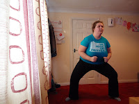 Pippa doing a Squat following the Your Shape on the Xbox 360
