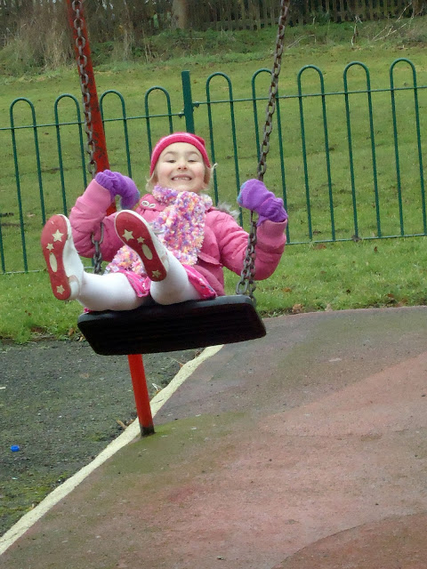 Top Ender on the Swings at the Park