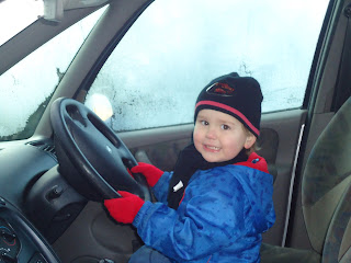 Baby Boy pretending to drive the Car