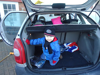 Baby Boy climbing about the inside of the Car