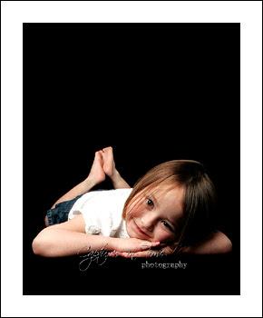 Kansas City Child Photographer girl sweet pose black backdrop