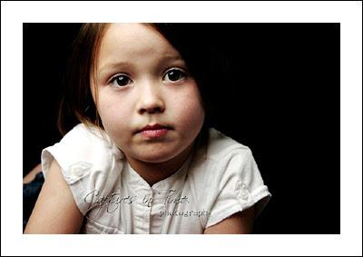 Kansas City Child Photographer girl sad face black backdrop