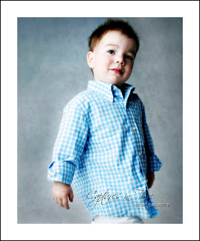 Kansas City Child Photographer boy in checkered blue shirt