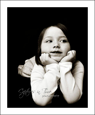 Kansas City Child Photographer girl in black and white head on hands
