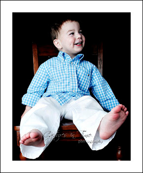 Kansas City Child Photographer boy sitting on chair black backdrop