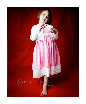 Kansas City Child Photographer girl on red backdrop pink dress