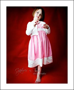 Kansas City Child Photographer girl on red backdrop pink dress