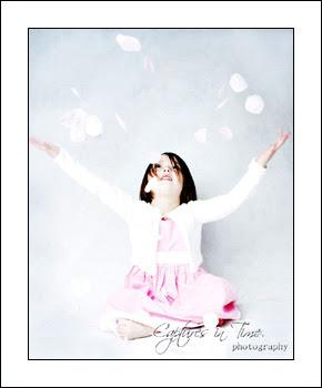 Kansas City Child Photographer girl throwing flower petals