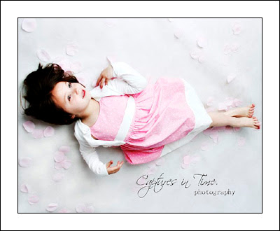 Kansas City Child Photographer girl laying in flower petals
