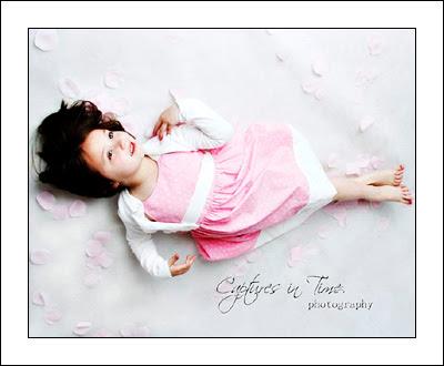 Kansas City Child Photographer girl laying in flower petals