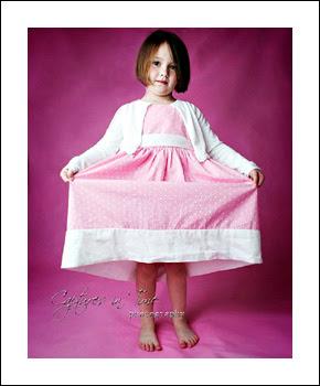 Kansas City Child Photographer girl on pink backdrop with pink dress