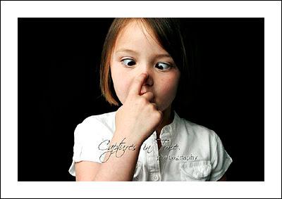Kansas City Child Photographer girl crossing eyes