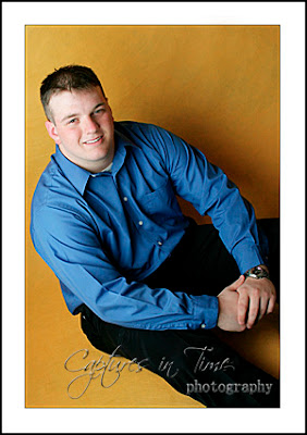 Kansas City Senior Photographer senior boy yellow backdrop