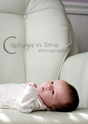 Kansas City Newborn Photos newborn girl on green chair