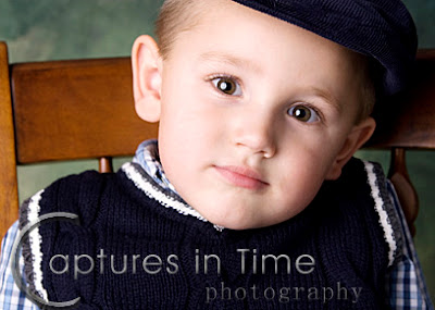 Kansas City Child Photos boy with a hat on with big brown eyes